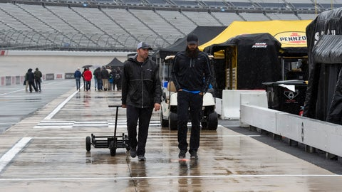 <p>               People walk in the pits area as rain falls before a NASCAR Cup series auto race at Dover International Speedway in Dover, Del., Sunday, May 5, 2019. (AP Photo/Jason Minto)             </p>