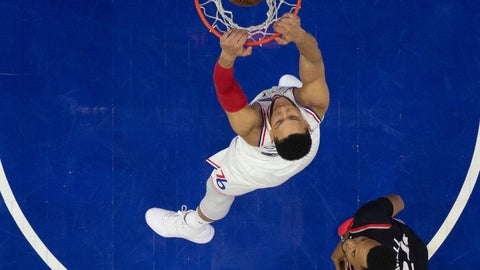 <p>               Philadelphia 76ers' Ben Simmons dunks as Toronto Raptors' Norman Powell, right, watches during the first half of Game 3 of a second-round NBA basketball playoff series Thursday, May 2, 2019, in Philadelphia. The 76ers won 116-95. (AP Photo/Chris Szagola)             </p>