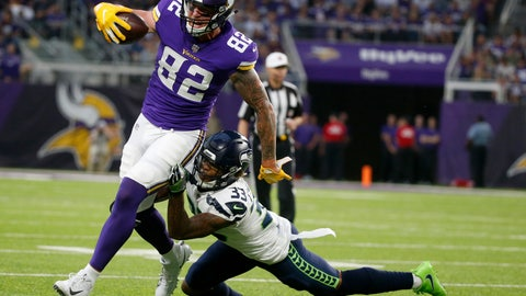<p>               FILE - In this Friday, Aug. 24, 2018 file photo, Minnesota Vikings tight end Kyle Rudolph (82) runs from Seattle Seahawks defensive back Tedric Thompson after making a reception during the first half of an NFL preseason football game in Minneapolis. Just because the Minnesota Vikings drafted a tight end, Irv Smith Jr., in the second round doesn't mean they're going to cut or trade veteran Kyle Rudolph. There's room for both of them in the offense, as long as the Vikings can make space under the salary cap. (AP Photo/Bruce Kluckhohn, File)             </p>