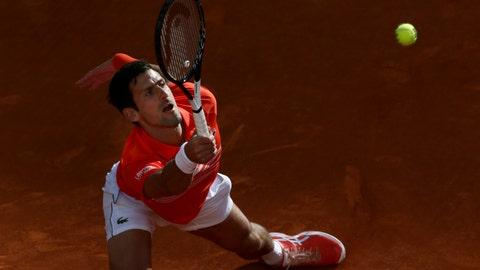 <p>               Serbia's Novak Djokovic plays a shot against Greece's Stefanos Tsitsipas during the final of the Madrid Open tennis tournament in Madrid, Spain, Sunday, May 12, 2019. (AP Photo/Bernat Armangue)             </p>
