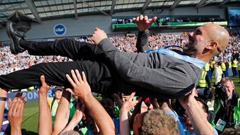 <p>               Manchester City coach Pep Guardiola is lifted in the air by the players after the English Premier League soccer match between Brighton and Manchester City at the AMEX Stadium in Brighton, England, Sunday, May 12, 2019. Manchester City defeated Brighton 4-1 to win the championship. (AP Photo/Frank Augstein)             </p>