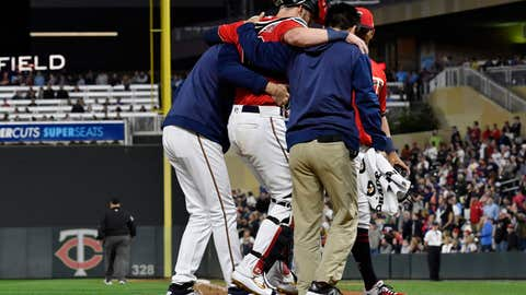 <p>               Minnesota Twins' catcher Mitch Garver is helped off the field after he was injured tagging out Los Angeles Angels' Shohei Ohtani as he attempted to score from second base on a hit by Brian Goodwin in the eighth inning of a baseball game Tuesday, May 14, 2019, in Minneapolis. The Twins won 4-3. (AP Photo/Jim Mone)             </p>