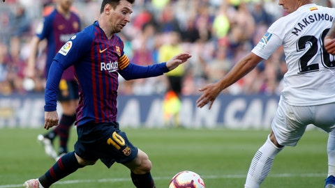 <p>               Barcelona forward Lionel Messi fights for the ball against Getafe's Nemanja Maksimovic during the Spanish La Liga soccer match between FC Barcelona and Getafe at the Camp Nou stadium in Barcelona, Spain, Sunday, May 12, 2019. (AP Photo)             </p>