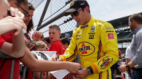<p>               Helio Castroneves, of Brazil, signs autographs for fans during practice for the Indianapolis 500 IndyCar auto race at Indianapolis Motor Speedway, Thursday, May 16, 2019 in Indianapolis. (AP Photo/Michael Conroy)             </p>