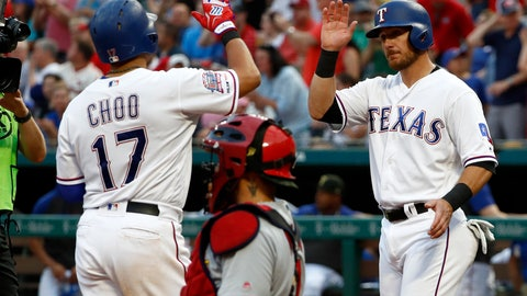 <p>               Texas Rangers' Shin-Soo Choo, left, and Jeff Mathis, right, celebrate Choo's two-run home run that scored Mathis as St. Louis Cardinals catcher Yadier Molina, kneels by the plate in the second inning of a baseball game in Arlington, Texas, Friday, May 17, 2019. (AP Photo/Tony Gutierrez)             </p>