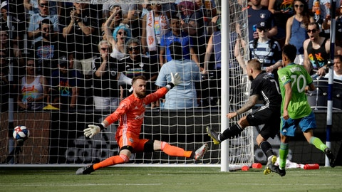 <p>               Sporting Kansas City forward Johnny Russell (7) gets the ball past Seattle Sounders goalkeeper Stefan Frei, left, to score a goal during the first half of an MLS soccer match Sunday, May 26, 2019, in Kansas City, Kan. (AP Photo/Charlie Riedel)             </p>