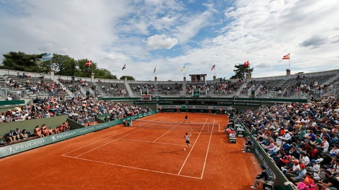 <p>               Lauren Davis of the U.S., foreground, plays a shot against Britain's Johanna Konta during their second round match of the French Open tennis tournament at the Roland Garros stadium in Paris, Wednesday, May 29, 2019. (AP Photo/Pavel Golovkin)             </p>
