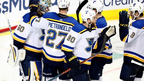 <p>               St. Louis Blues goaltender Jordan Binnington (50) celebrates with Alex Pietrangelo (27), Ryan O'Reilly (90), David Perron, center rear, and Sammy Blais (9), following the team's 4-1 win against the Dallas Stars in Game 6 of an NHL second-round hockey playoff series in Dallas, Sunday, May 5, 2019. (AP Photo/Tony Gutierrez)             </p>