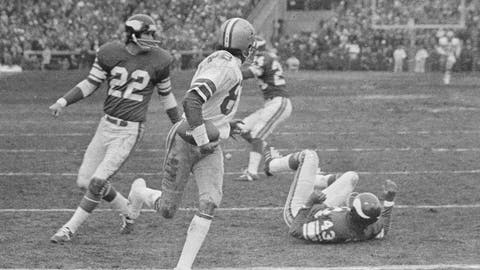 """<p>               FILe - In this Dec. 28, 1975, file photo Dallas Cowboys wide receiver Drew Pearson (88) nears the end zone with the game-winning 50-yard touchdown pass late in the fourth quarter as the Cowboys defeated the Minnesota Vikings in the NFC playoff NFL football game in Bloomington, Minn. Hail Mary: Credit Hall of Famer Roger Staubach with this. After the Cowboys quarterback completed a late 50-yard pass to Pearson to win a playoff game at Minnesota, Staubach said: """"I guess you could call it a Hail Mary. You throw it up and pray."""" (AP Photo/File)             </p>"""