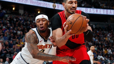 <p>               Denver Nuggets forward Torrey Craig, left, runs into Portland Trail Blazers center Enes Kanter, who pulls in a rebound during the first half of Game 2 of an NBA basketball second-round playoff series Wednesday, May 1, 2019, in Denver. (AP Photo/David Zalubowski)             </p>