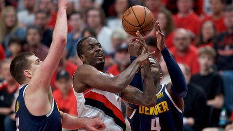 <p>               Portland Trail Blazers forward Al-Farouq Aminu, center, shoots between Denver Nuggets forward Paul Millsap, right, and center Nikola Jokic, left, during the first half of Game 4 of an NBA basketball second-round playoff series Sunday, May 5, 2019, in Portland, Ore. (AP Photo/Craig Mitchelldyer)             </p>