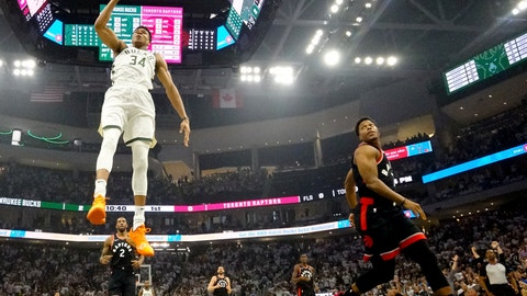 <p>               Milwaukee Bucks' Giannis Antetokounmpo dunks during the first half of Game 1 of the NBA Eastern Conference basketball playoff finals against the Toronto Raptors Wednesday, May 15, 2019, in Milwaukee. (AP Photo/Morry Gash)             </p>