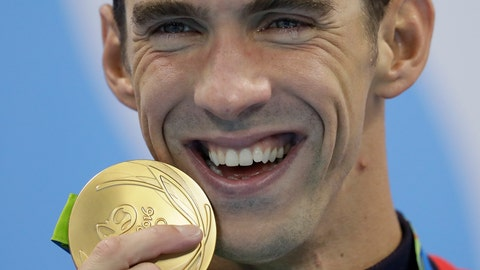 <p>               FILE - In this Aug. 9, 2016, file photo, Michael Phelps has tears in his eyes as he shows off his gold medal after the men's 200-meter butterfly final during the swimming competitions at the 2016 Summer Olympics, in Rio de Janeiro, Brazil. While swimming to Olympic glory, Phelps found comfort in the pool and quite a bit of angst out of it. Because he is willing to share his story of depression and raise awareness of mental health issues, Phelps will be awarded the fifth annual Morton E. Ruderman Award in Inclusion on Tuesday night, May 21, 2019, in Boston. (AP Photo/Michael Sohn, File)             </p>