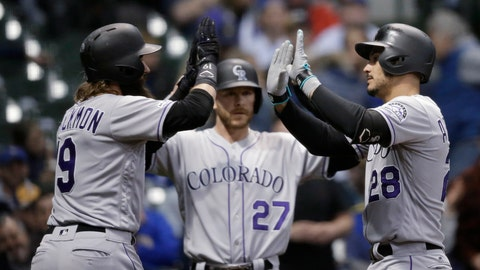 <p>               Colorado Rockies' Nolan Arenado, right, gets high-fives from Charlie Blackmon, left and Trevor Story after his three-run home run against the Milwaukee Brewers during the first inning of a baseball game Wednesday, May 1, 2019, in Milwaukee. (AP Photo/Jeffrey Phelps)             </p>