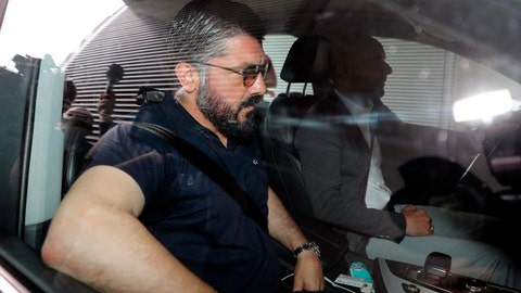 <p>               AC Milan coach Rino Gattuso arrives at the team's headquarters in Milan, Italy, Tuesday, May 28, 2019. (Matteo Bazzi/ANSA via AP)             </p>