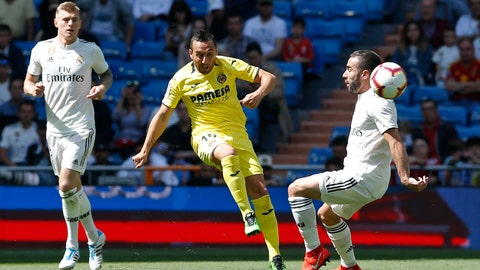 <p>               Villarreal's Santi Cazorla, centre, kicks the ball past Real Madrid's Dani Carvajal, right, during a Spanish La Liga soccer match between Real Madrid and Villarreal at the Santiago Bernabeu stadium in Madrid, Spain, Sunday, May 5, 2019. (AP Photo/Paul White)             </p>
