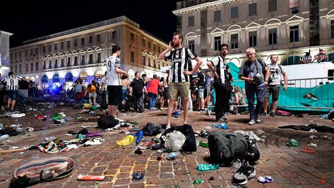 <p>               FILE - In this Saturday, June 3, 2017 file photo, Juventus fans leave San Carlo's square at the end of the Champions League final soccer match between Juventus and Real Madrid, in Turin, Italy. Four young men have been convicted of the deaths of two women in the stampede they caused among soccer fans using an irritating spray to trigger panic so they could steal wallets and phones in the crowd, Friday, May 17, 2019.  (Alessandro Di Marco/ANSA via AP)             </p>