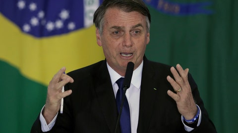 <p>               Brazil's President Jair Bolsonaro speaks during a ceremony where he signed a second decree that eases gun restrictions, during the signing ceremony at Planalto presidential palace in Brasilia, Brazil, Tuesday, May 7, 2019. The decree opens Brazil's market to guns and ammunition made outside of Brazil according to a summary of the decree. Gun owners can now buy between 1,000 -5,000 rounds of ammunition per year depending on their license, up from 50 rounds. Lower-ranking military members can now carry guns after 10 years of service. (AP Photo/Eraldo Peres)             </p>