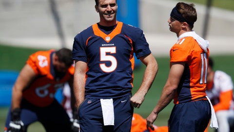 <p>               Denver Broncos quarterback Joe Flacco, left, jokes with wide receiver River Cracraft as they take part in drills during an NFL football organized training activity session at the team's headquarters Monday, May 13, 2019, in Englewood, Colo. (AP Photo/David Zalubowski)             </p>