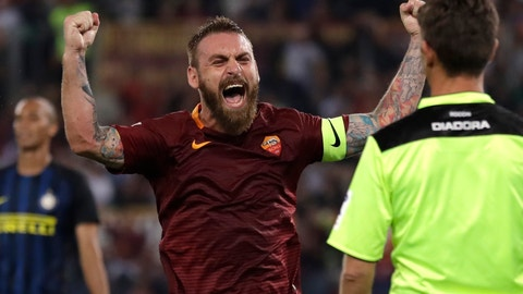 <p>               FILE - In this Oct. 2, 2016 file photo, Roma's Daniele De Rossi celebrates after his teammate Kostas Manolas scored during a Serie A soccer match between Roma and Inter Milan, at Rome's Olympic Stadium. Roma captain Daniele De Rossi surprisingly announced on Tuesday, May 14, 2019 he is leaving his hometown club after 18 years. (AP Photo/Andrew Medichini, file)             </p>