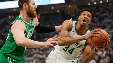 <p>               Milwaukee Bucks' Giannis Antetokounmpo looks to shoot past Boston Celtics' Aron Baynes during the first half of Game 2 of a second round NBA basketball playoff series Tuesday, April 30, 2019, in Milwaukee. (AP Photo/Morry Gash)             </p>