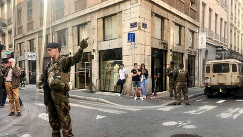 """<p>               Soldiers of French anti terrorist plan """"Vigipirate Mission"""", secure the area, near the site of a suspected bomb attack in central Lyon, Friday May, 24, 2019. A small explosion Friday on a busy street in the French city of Lyon lightly injured several people, local officials said.  (AP Photo/Sebastien Erome)             </p>"""