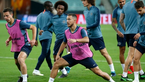 <p>               Chelsea's Eden Hazard, center, stretches during a soccer training session at the Olympic stadium in Baku, Azerbaijan, Tuesday May 28, 2019. English Premier League teams Arsenal and Chelsea are preparing for the Europa League Final soccer match that takes place in Baku on Wednesday night. (AP Photo/Darko Bandic)             </p>