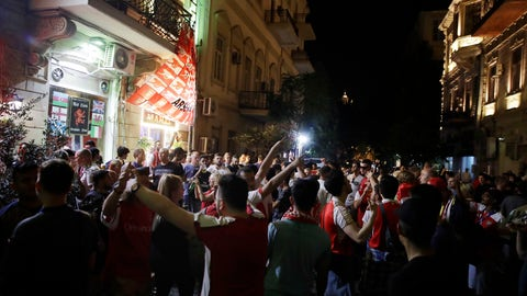 <p>               Arsenal supporters stand outside a pub in Baku, Azerbaijan, Tuesday May 28, 2019. English Premier League teams Arsenal and Chelsea are preparing for the Europa League Final soccer match that takes place in Baku on Wednesday night. (AP Photo/ Luca Bruno)             </p>