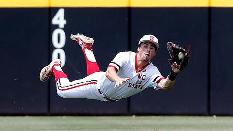 <p>               North Carolina State's Tyler McDonough (13) makes a diving catch of the ball hit by Campbell's Collin Wolf during the first inning at the NCAA college baseball regional tournament, Friday, May 31, 2019,  in Greenville, N.C. (Ethan Hyman/The News & Observer via AP)             </p>