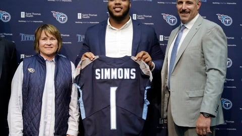 <p>               Mississippi State defensive tackle Jeffery Simmons, center, poses with Tennessee Titans owner Amy Adams Strunk, left, and head coach Mike Vrabel, right, during an NFL football news conference Friday, April 26, 2019, in Nashville, Tenn. Simmons was selected in the first round by the Titans. (AP Photo/Mark Humphrey)             </p>