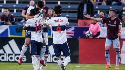 <p>               Vancouver Whitecaps forward Fredy Montero celebrates with teammates Lass Bangoura (19) and Hwang Inbeom (4) after scoring a goal against the Colorado Rapids during the first half of an MLS soccer match Friday, May 3, 2019, in Commerce City, Colo. (AP Photo/Jack Dempsey)             </p>