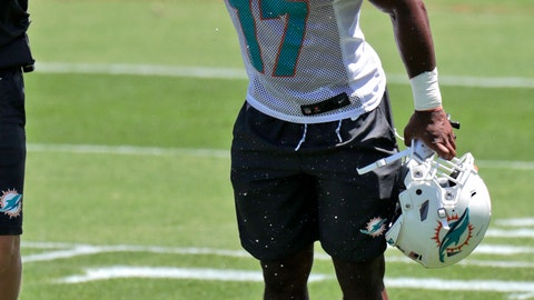 <p>               Miami Dolphins running back Mark Walton (17) sprays his face with water during NFL football rookie minicamp, Saturday, May 11, 2019, in Davie, Fla. (AP Photo/Lynne Sladky)             </p>