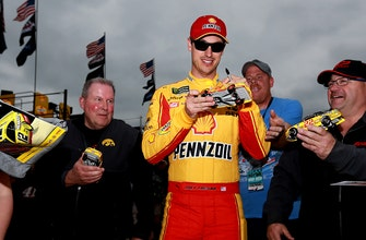 America's Crew Chief: Larry Mac gives a thumbs up to Joey Logano for hanging out with fans during rain delay