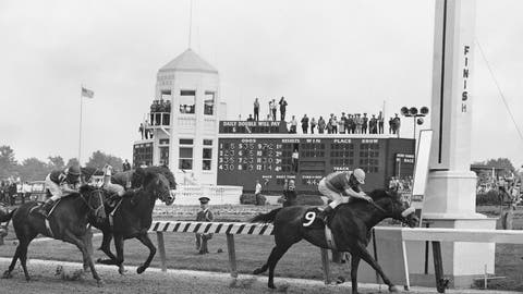 <p>               FILE - In this May 4, 1968, file photo, Dancer's Image, right, jockey Bob Ussery up, crosses the finish line to win the 94th running of the Kentucky Derby at Churchill Downs in Louisville, Ky. Forward pass, center, was second, and Francie's Hat, left, was third. Sent off as the 7-2 second choice, Dancer's Image rallied from last to win by 1 1/2 lengths over Forward Pass. The result was declared official, but Dancer's Image was later disqualified after traces of phenylbutazone, known as bute, were found in Dancer's Image's post-race urinalysis. Dancer's Image was placed 14th and last; Forward Pass was declared the winner. (AP Photo/File)             </p>