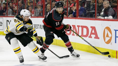 <p>               Boston Bruins' Brad Marchand (63) chases the puck with Carolina Hurricanes' Brett Pesce (22) during the first period in Game 4 of the NHL hockey Stanley Cup Eastern Conference final series in Raleigh, N.C., Thursday, May 16, 2019. (AP Photo/Gerry Broome)             </p>