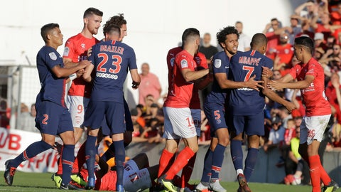 <p>               FILE. In this Sept. 1, 2018 file photo PSG's Kylian Mbappe, 2nd right, argues as Nimes' Teji Savanier, left, lies on the pitch during their League One soccer match between Nimes and Paris Saint-Germain at Jean-Bouin stadium in Nimes, southern France. After helping Nimes to promotion last season with four goals and nine assists, Savanier made headlines for the wrong reasons last September following an altercation with Paris Saint-Germain star Kylian Mbappé that resulted in a five-match ban. (AP Photo/Claude Paris)             </p>