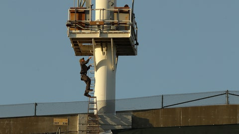 <p>               A technician climbs the left field lighting structure at the Oakland Coliseum in attempt to fix extinguished lights prior to the baseball game between the Cincinnati Reds and the Oakland Athletics on Tuesday, May 7, 2019, in Oakland, Calif. The game's start was delayed for work on the lights. (AP Photo/Ben Margot)             </p>
