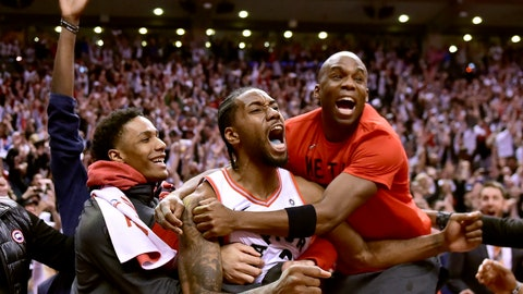 <p>               Toronto Raptors forward Kawhi Leonard (2) celebrates his last-second basket with teammates at the end of the second half of an NBA Eastern Conference semifinal basketball game against the Philadelphia 76ers in Toronto on Sunday, May 12, 2019. (Frank Gunn/The Canadian Press via AP)             </p>