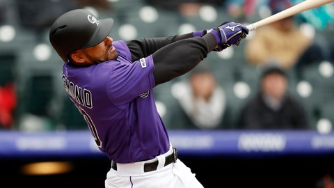 <p>               Colorado Rockies' Ian Desmond hits a two-run home run of San Francisco Giants starting pitcher Derek Holland in the second inning of a baseball game Thursday, May 9, 2019, in Denver. (AP Photo/David Zalubowski)             </p>