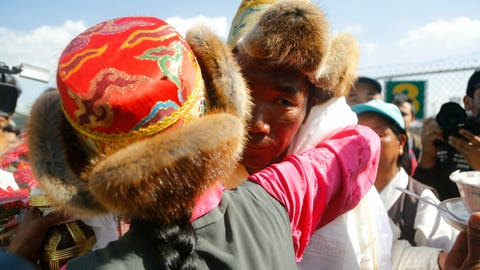 <p>               Nepalese veteran Sherpa guide Kami Rita, 49, is welcomed by his sister at the airport in Kathmandu, Nepal, Saturday, May 25, 2019. The Sherpa mountaineer extended his record for successful climbs of Mount Everest with his 24th ascent of the world's highest peak on Tuesday. (AP Photo/Niranjan Shrestha)             </p>