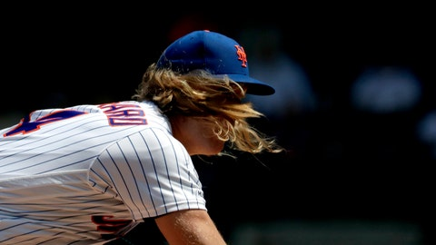 <p>               New York Mets starting pitcher Noah Syndergaard's hair flies forward as he pitches to Cincinnati Reds' Jesse Winker during the first inning of a baseball game, Thursday, May 2, 2019, in New York.(AP Photo/Julio Cortez)             </p>