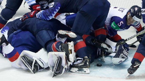 <p>               Great Britain's Ben Davies, right, reaches for the puck during the Ice Hockey World Championships group A match between the United States and Great Britain at the Steel Arena in Kosice, Slovakia, Wednesday, May 15, 2019. (AP Photo/Petr David Josek)             </p>