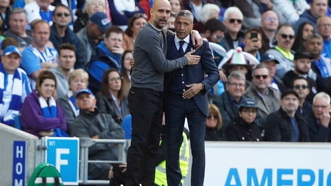 <p>               Manchester City coach Pep Guardiola and Brighton manager Chris Hughton, right, embrace each other during the English Premier League soccer match between Brighton and Manchester City at the AMEX Stadium in Brighton, England, Sunday, May 12, 2019. (AP Photo/Frank Augstein)             </p>