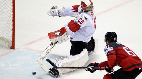 <p>               Canada's Mark Stone, right, scores his side's third goal past Switzerland's goalkeeper Leonardo Genoni during the Ice Hockey World Championships quarterfinal match between Canada and Switzerland at the Steel Arena in Kosice, Slovakia, Thursday, May 23, 2019. (AP Photo/Petr David Josek)             </p>
