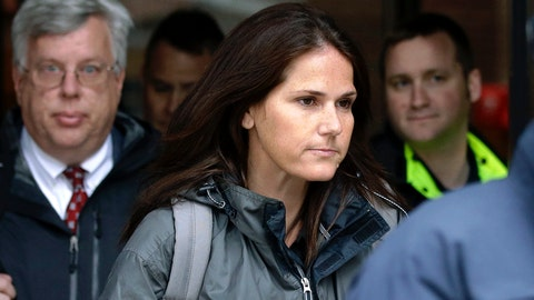 <p>               Former University of Southern California soccer coach Laura Janke departs federal court, Tuesday, May 14, 2019, in Boston, where she pleaded guilty to charges in a nationwide college admissions bribery scandal. (AP Photo/Steven Senne)             </p>
