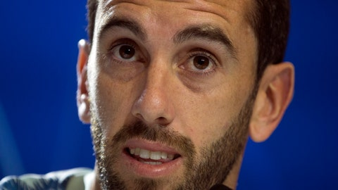 <p>               FILE - In this Tuesday Oct. 2, 2018 file photo, Atletico Madrid's Diego Godin speaks during a press conference in Madrid, Spain. Uruguay defender Diego Godin is not staying with Atletico Madrid after this season Godin announced Tuesday, May 7, 2019 that he is leaving after not reaching a deal to renew his contract with the Spanish club. (AP Photo/Paul White, file)             </p>