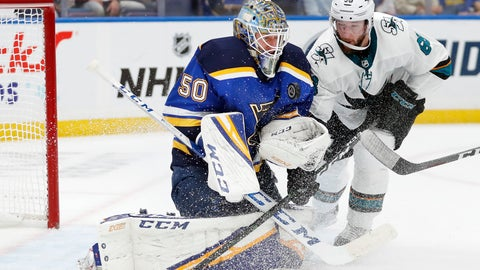 <p>               St. Louis Blues goaltender Jordan Binnington (50) protects the puck as San Jose Sharks center Melker Karlsson (68), of Sweden, closes in during the second period in Game 4 of the NHL hockey Stanley Cup Western Conference final series Friday, May 17, 2019, in St. Louis. (AP Photo/Jeff Roberson)             </p>