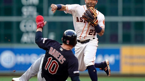<p>               Houston Astros second baseman Jose Altuve (27) throws to first as he tries to turn a double play as Cleveland Indians' Jake Bauers (10) slides into second base during the third inning of a baseball game Sunday, April 28, 2019, in Houston. Bauers was out at second and Francisco Lindor was safe at first. (AP Photo/David J. Phillip)             </p>