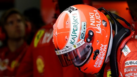 <p>               The name of three-time Formula One world champion Niki Lauda is written on the helmet of Ferrari driver Sebastian Vettel of Germany during the second practice session at the Monaco racetrack, in Monaco, Thursday, May 23, 2019. Three-time Formula One world champion Niki Lauda, who won two of his titles after a horrific crash that left him with serious burns and went on to become a prominent figure in the aviation industry, has died on May 21, 2109. He was 70. (AP Photo/Luca Bruno)             </p>
