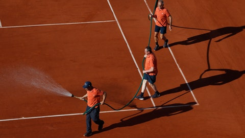 <p>               Stadium workers spray the clay court during the third round match of the French Open tennis tournament between Sloane Stephens of the U.S. and Slovenia's Polona Hercog at the Roland Garros stadium in Paris, Friday, May 31, 2019. (AP Photo/Pavel Golovkin)             </p>